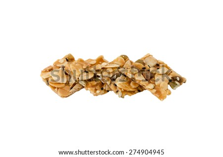 four pieces of almond and seeds mix with caramel on white background