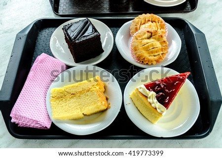 four pieces of different cakes