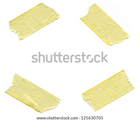 Four pieces of masking tape over white background. - stock photo