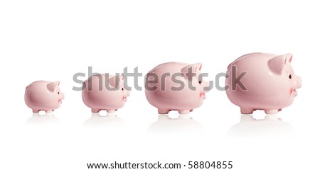 Four piggy banks in a row (investment and development concept) - stock photo