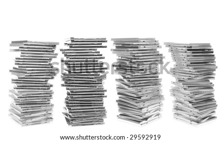 Four piles of disc cases. Isolated on white. White space at the top.
