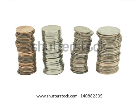 Four piles of US coins Stacked on white background. - stock photo
