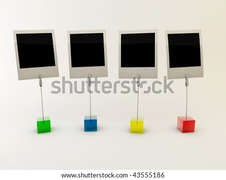 four plastic cubes with clamps, holding four photos with room for your pictures.