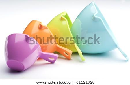 Four Plastic Measuring Cups - stock photo