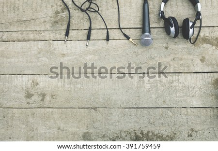 four plug microphone, headset on an old wooden surface - stock photo