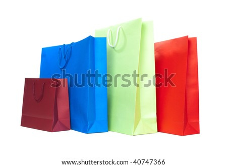 Four present bags in different colors on white background - stock photo