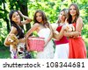 Four pretty young caucasian women in the park - stock photo