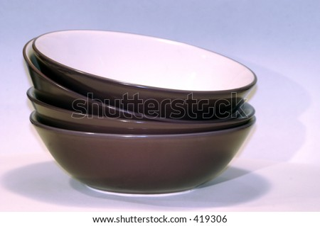 Four Purple bowls stacked on top of each other - stock photo