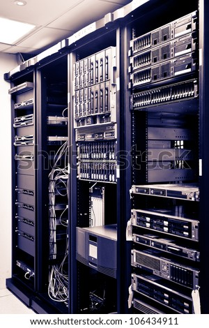 Four Racks Network servers in a data center. - stock photo