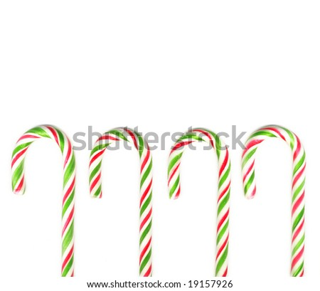 Four red and green Christmas candy canes isolated on white (real photo)