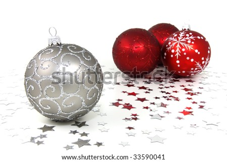 Four red and silver christmas baubles with silver stars on white background - stock photo