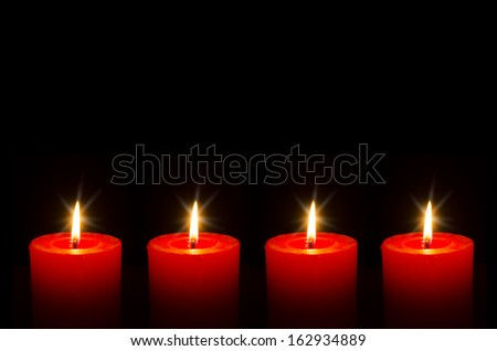 Four red burning candle for Advent - stock photo