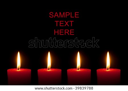 Four red candles, black background - stock photo