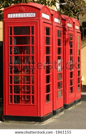 Four red telephone boxes - stock photo