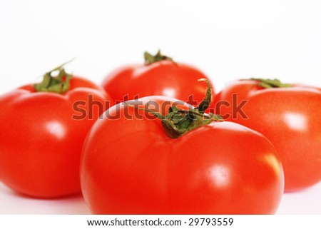 Four red tomatoes isolated. White background - stock photo