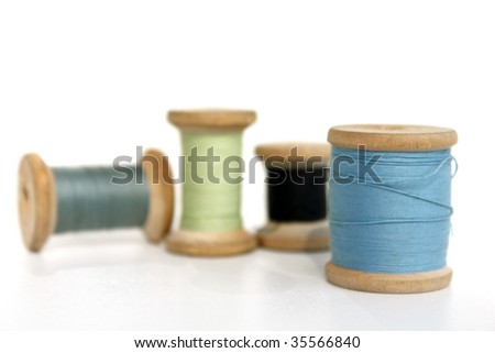 Four reels  with threads of different color