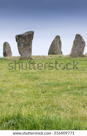 Four remaining Neolithic Standing Stones at Nine Stones Close, Harthill Moor Derbyshire, England. The stones are around 2m tall - stock photo