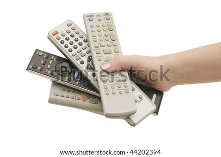 Four remote control in a hand isolated - stock photo