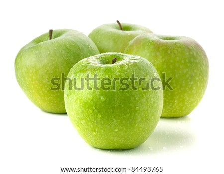 Four ripe green apples. Isolated on white