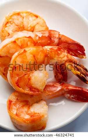 Four roasted tiger prawn on plate are ready to serve