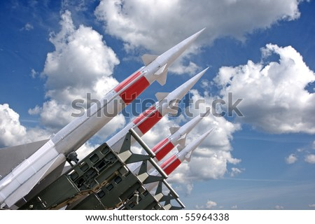 Four rockets of a surface-to-air missile system are aimed in the sky