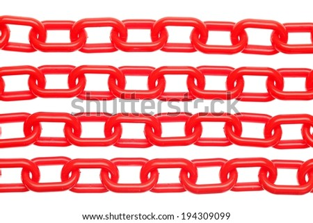 Four rows of red interlocking chain made of plastic. - stock photo