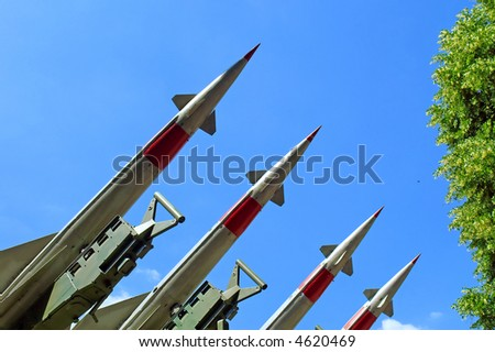 """Four Russian anti-aircraft missiles of """"S"""" class in park. Shot in June, near Dnieper river (Dniepropetrovsk, Ukraine). - stock photo"""