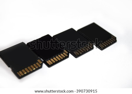 Four SD black memory cards over white background