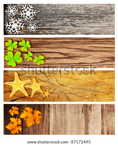 Four season wooden banners, collage of abstract natural backgrounds with seasonal symbols, life cycle concept - stock photo