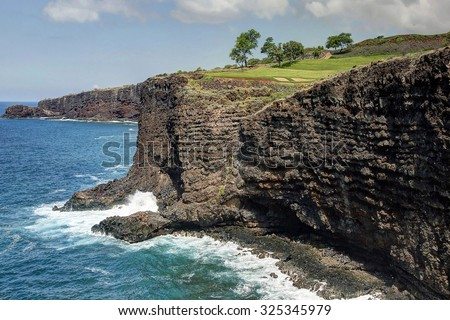 """Four Seasons Manele Bay Golf Course - Signature 12th Hole - Island of Lanai, Hawaii.  View from the coastal hiking trail known as, """"The Fisherman's Trail"""". - stock photo"""