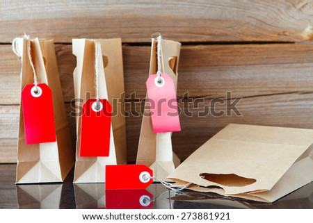 four shopping bags and  with a price tag - stock photo
