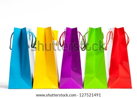 four shopping bags in a row on white background
