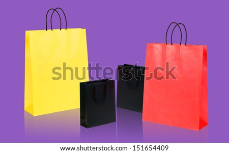 Four shopping bags on violet.