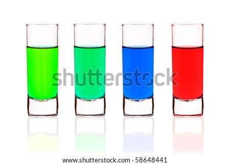 Four shot-glasses of brightly-colored cocktails - isolated on white ground - stock photo