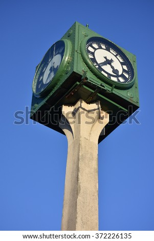 Four-sided clock tower. - stock photo
