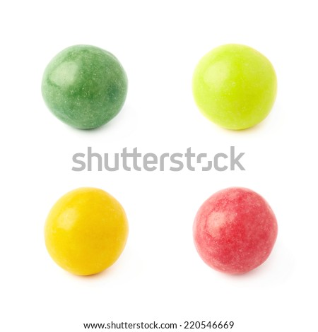 Four single chewing gum balls, close-up composition isolated over the white background, set of four color versions - stock photo