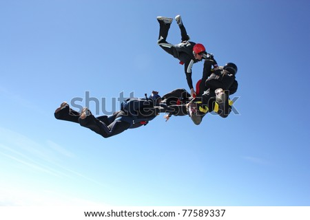 Four skydivers after they have exit an airplane - stock photo