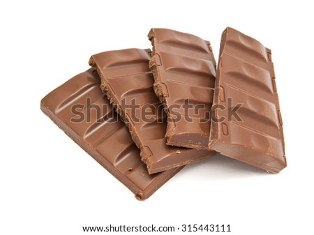 four slices of chocolate on white background