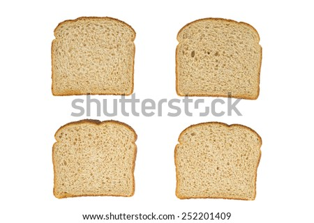 Four slices of wheat bread as viewed from top on white - stock photo