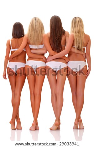 Four slim suntanned young women in full growth, in white underwear, isolated on a white background, please see some of my other parts of a body images: - stock photo
