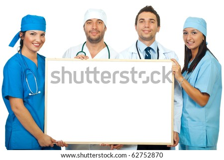 Four smiling different doctors holding a blank banner
