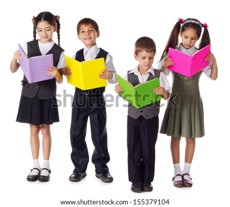 Four smiling schoolchild standing with colorful books, isolated on white