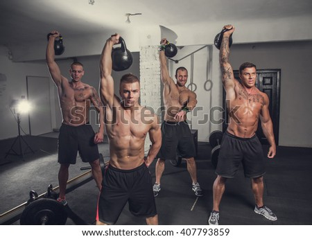 Four sporty muscular guys exercising with lighting weights.