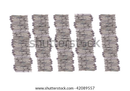 Four stack of newspapers isolated on white - stock photo