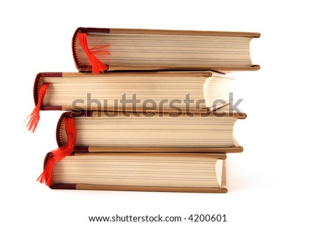 Four stacked books with red bookmarks isolated on white background.