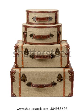 Four Stacked Deco Burlap Suitcases. The image is a cut out, isolated on a white background.