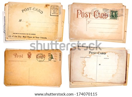 Four stacks of blank, heavily aged post cards from early 1900s.  Isolated on white. - stock photo