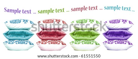 Four stacks of colorful cushions stacked up with space for text - stock photo