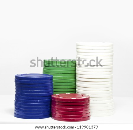 Four stacks of different colored chips - stock photo