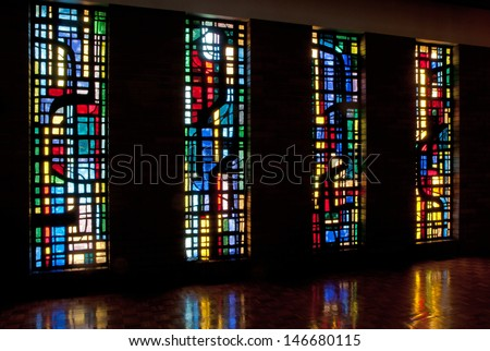 Four stained glass windows and reflections in chapel of Saint Benedict's Monastery, Winnipeg, Manitoba, Canada, designed by the late Gabriel Loire of Chartres, France - stock photo